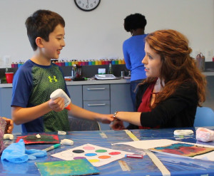David and Colleen work on a craft project at the Hussman Institute.